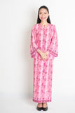 Asian woman in pink batik dress Stock Photo