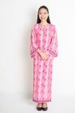 Asian woman in pink batik dress Stock Photo