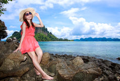 Asian woman in a pink dress relaxing Stock Photos