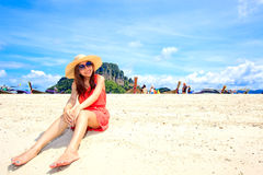 Asian woman in a pink dress relaxing on the beach Royalty Free Stock Photo