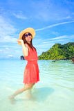 Asian woman in a pink dress standing on the beach Royalty Free Stock Photo