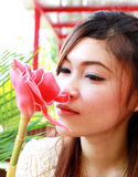 Asian woman with pink flower Stock Images