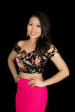 Asian woman pink skirt standing on black hands on hips smile Stock Images