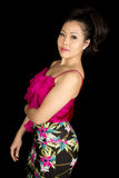 Asian woman pink top standing on black side looking Royalty Free Stock Photography