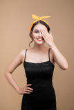 Asian woman with pinup makeup cover eyes by hands. Stock Image