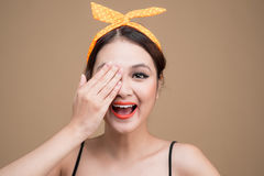 Asian woman with pinup makeup cover eyes by hands. Asian woman with pinup makeup cover eyes by hands Stock Photography
