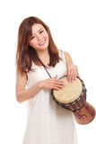Asian woman playing a djembe Royalty Free Stock Photography