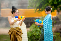 Asian woman playing a gun on Songkran festival. Asian women playing a gun on Songkran festival Royalty Free Stock Image