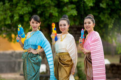 Asian woman playing a gun on Songkran festival. Asian women playing a gun on Songkran festival Stock Photo