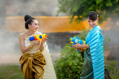 Asian woman playing guns in the Songkran Festival fun. Asian women playing guns in the Songkran Festival fun Royalty Free Stock Photography