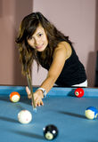 Asian woman playing pool Royalty Free Stock Images