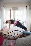 Asian woman playing yoga in home bed room. Asian woman playing   yoga in home bed room Stock Images