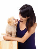 Asian woman with poodle Stock Photos
