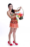Asian woman portable fruit basket Stock Photo