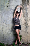 Asian woman portrait. A beautifull woman is standing in fornt of the wall Royalty Free Stock Photos