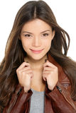 Asian woman portrait of modern female in her 20s. Wearing leather jacket looking at camera with subtle smile. Beautiful trendy cool hipster girl. Multi-ethnic Stock Photo
