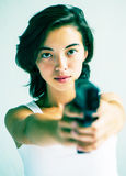 Asian woman. Portrait of a pretty Asian woman who is holding a gun Stock Images
