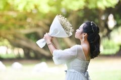 Women Hold bouquet Flower Give flowers. Asian woman Portrait of smiling bride hold bouquet Flower Give flowers Royalty Free Stock Images