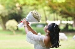 Women Hold bouquet Flower Give flowers Royalty Free Stock Images