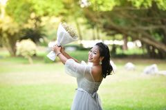 Women Hold bouquet Flower Give flowers. Asian woman Portrait of smiling bride hold bouquet Flower Give flowers Stock Photography