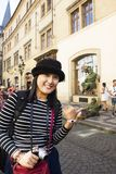 Asian woman posing with Czechia actor  acting Magic show on street. For show people and travelers near Charles Bridge on August 30, 2017 in Prague, Czech Royalty Free Stock Photo