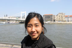 Asian woman posing in Danube river, Budapest Royalty Free Stock Photography