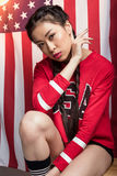 Asian woman posing in front of USA flag, Independence Day of America Royalty Free Stock Photo