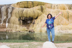 Asian woman standing by hot springs terrace Stock Photo