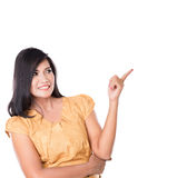 Asian woman posing pointing at something above Royalty Free Stock Photo