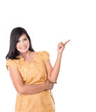 Asian woman posing pointing at something above Stock Images