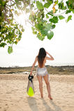 Asian woman posing relax holding fin on the beach. Stock Photography