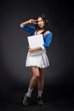 Asian Woman Posing With Blank Poster In Studio Stock Photo