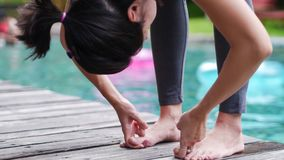 Asian woman practice Yoga Pose standing hand catch toe close up Royalty Free Stock Photos