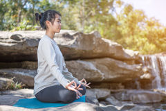 Asian woman practices yoga Royalty Free Stock Images