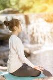 Asian woman practices yoga Stock Photo