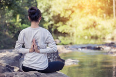 Asian woman practices yoga Royalty Free Stock Image
