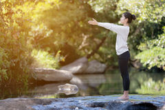 Asian woman practices yoga Stock Images