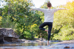 Asian woman practices yoga Stock Photos