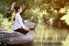 Asian woman practices yoga Royalty Free Stock Photo