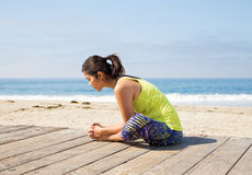 Asian woman practicing yoga at beach Royalty Free Stock Photography