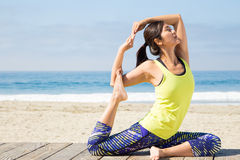 Asian woman practicing yoga at beach Stock Images