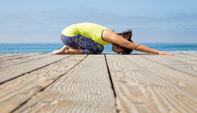 Asian woman practicing yoga at beach Royalty Free Stock Photo