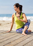 Asian woman practicing yoga at beach Stock Photos