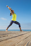 Asian woman practicing yoga at beach Stock Photo