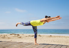 Asian woman practicing yoga at beach Royalty Free Stock Photography