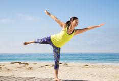 Asian woman practicing yoga at beach Royalty Free Stock Photos