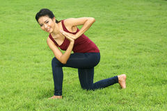 Asian woman practicing yoga Stock Photo