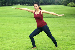 Asian woman practicing yoga Stock Image