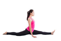 Asian woman practicing yoga, exercise called Monkey Pose, isolat Royalty Free Stock Images
