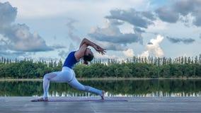 Asian woman practicing yoga pose Royalty Free Stock Image